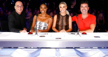 "This image released by NBC shows celebrity judges, from left, Howie Mandel, Gabrielle Union, Julianne Hough, Simon Cowell on the set of ""America's Got Talent,"" in Los Angeles."