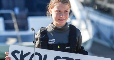 "Climate activist Greta Thunberg holds a ""Fridays for Future"" banner in Lisbon, Tuesday, Dec 3, 2019."