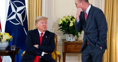 White House chief of staff Mick Mulvaney talks with US President Donald after his meeting with NATO Secretary General Jens Stoltenberg at Winfield House, Tuesday, Dec. 3, 2019, in London.