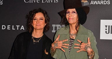 Actress Sara Gilbert (L) and singer-songwriter Linda Perry arrive for the traditional Clive Davis party on the eve of the 61th Annual Grammy Awards on February 9, 2019.