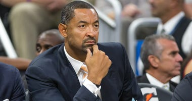 Assistant coach Juwan Howard of the Miami Heat on the bench on opening night against the Orlando Magic on October 26, 2016 at Amway Center in Orlando, Florida.