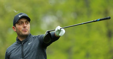 Francesco Molinari points with his club during practice before the 2019 PGA Championship at Bethpage Black.