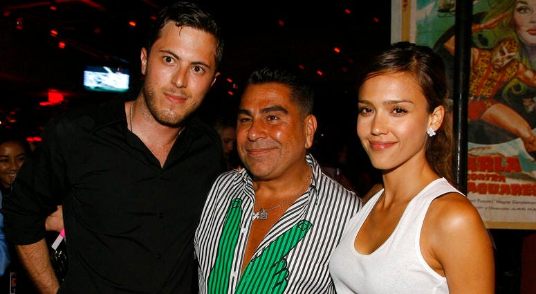June 28, 2007 file photo, Harry Morton, left, Luis Barajas, center, founder of Flaunt magazine, and Jessica Alba are seen at the opening of the Pink Taco restaurant in Los Angeles.