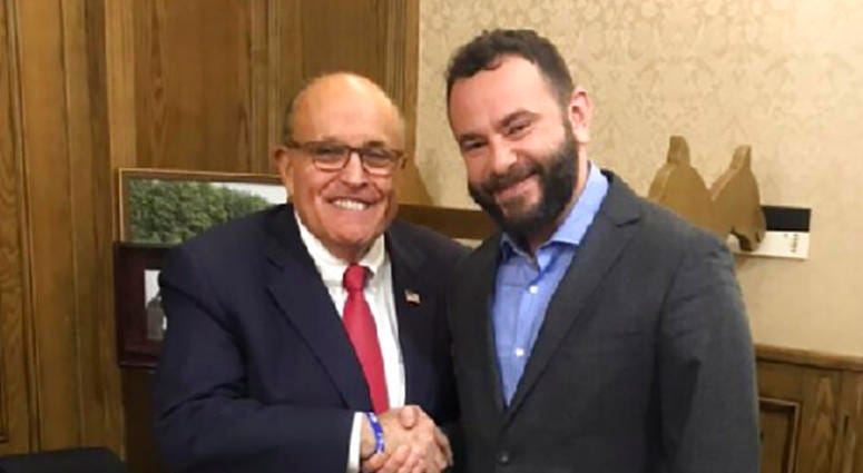In this handout photo provided by Oleksandr Dubinsky's press office and taken on late Thursday, Dec. 5, 2019, Rudy Giuliani, an attorney for U.S President Donald Trump, left, meets with Ukrainian lawmaker Oleksandr Dubinsky in Kyiv, Ukraine.