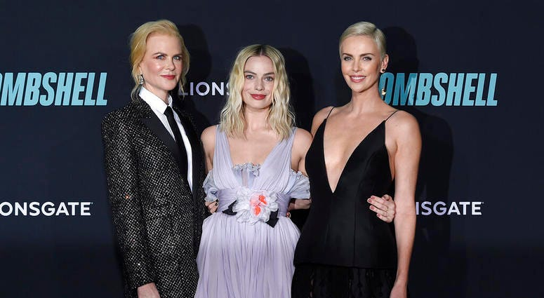 """Nicole Kidman, from left, Margot Robbie, and Charlize Theron attend the premiere of """"Bombshell"""" at Regency Village Theatre on Tuesday, Dec. 10, 2019, in Los Angeles."""