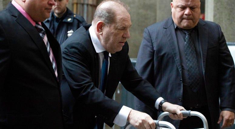 Harvey Weinstein, center, arrives for a court hearing, Wednesday, Dec. 11, 2019 in New York