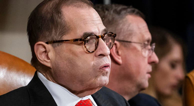 House Judiciary Committee Chairman Jerrold Nadler, D-N.Y., left, exhales after a day of work with Rep. Doug Collins, R-Ga., the ranking member, right, on the markup of articles of impeachment against President Donald Trump
