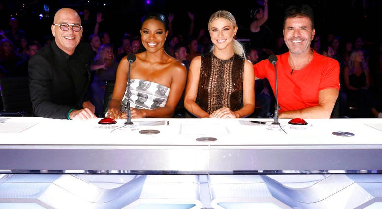 """This image released by NBC shows celebrity judges, from left, Howie Mandel, Gabrielle Union, Julianne Hough, Simon Cowell on the set of """"America's Got Talent,"""" in Los Angeles."""