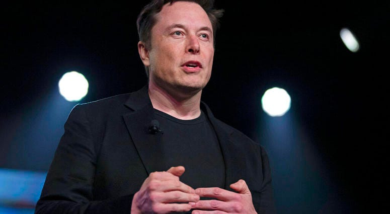 In this March 14, 2019, file photo, Tesla CEO Elon Musk speaks before unveiling the Model Y at Tesla's design studio in Hawthorne, Calif.