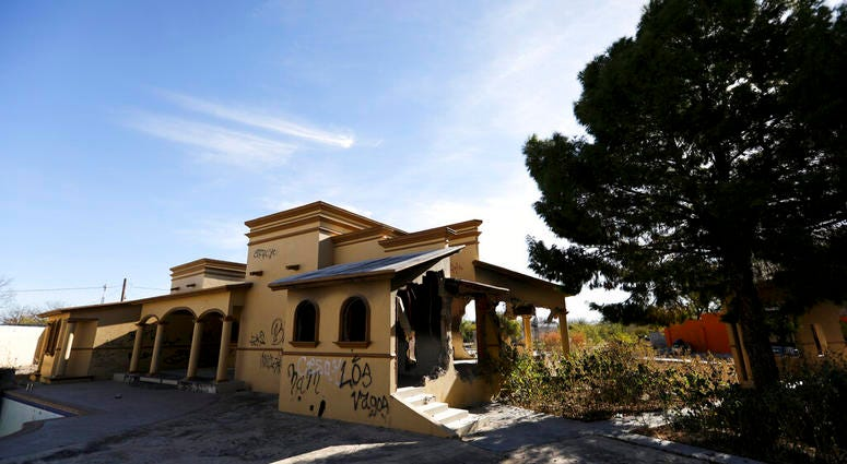 A view of a home torched by the Zetas cartel eight years back, in Allende, Coahuila state, Mexico, Tuesday, Dec. 3, 2019.