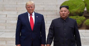"""President Donald Trump, left, meets with North Korean leader Kim Jong Un at the North Korean side of the border at the village of Panmunjom in Demilitarized Zone. North Korea threatened Thursday, Dec. 5, to resume insults of Trump and consider him a """"dota"""
