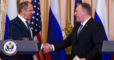 Secretary of State Mike Pompeo, right, departs with with Russian Foreign Minister Sergey Lavrov, after a media availability at the State Department, Tuesday, Dec. 10, 2019, in Washington.