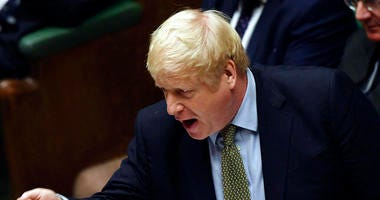 In this handout photo provided by the House of Commons, Britain's Prime Minister Boris Johnson gestures during the first Prime Minister's Questions of the year, in the House of Commons in London, Wednesday, Jan. 8, 2020.