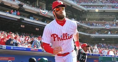 Bryce Harper emerges from the dugout on Opening Day in his Philadelphia Phillies debut.