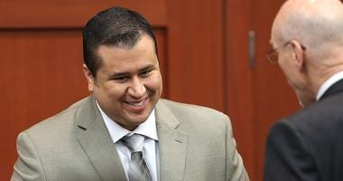 George Zimmerman smiles as he leaves the courtroom during a recess on the 21st day of his trial in Seminole circuit court, July 9, 2013 in Sanford, Florida.