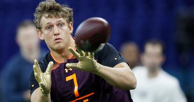 T.J. Hockenson of Iowa catches passes at the NFL Combine.