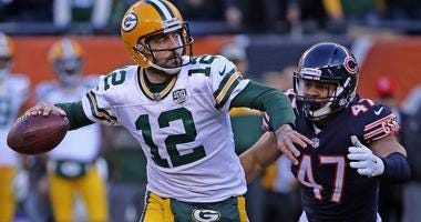 Green Bay Packers quarterback Aaron Rodgers looks to throw a pass in a game against the Chicago Bears in 2018.