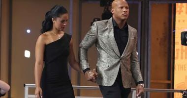Ryan Shazier of the Pittsburgh Steelers with Michelle Rodriguez at the 2018 NFL Draft.