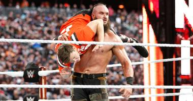 WWE star Braun Strowman lifts Colin Jost at Wrestlemania 35 in 2019 at MetLife Stadium.