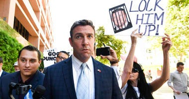 In this July 1, 2019, file photo, U.S. Rep. Duncan Hunter leaves federal court after a motions hearing in San Diego.