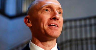 In this Nov. 2, 2017, photo, Carter Page, a foreign policy adviser to Donald Trump's 2016 presidential campaign, speaks with reporters following a day of questions from the House Intelligence Committee, on Capitol Hill in Washington.