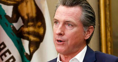 This Oct. 8, 2019, file photo, shows California Gov. Gavin Newsom during an interview in his office at the Capitol in Sacramento, Calif.