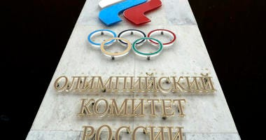 In this file photo dated Wednesday, Dec. 6, 2017, the logo of the Russian Olympic Committee at the entrance of the head office in Moscow, Russia.