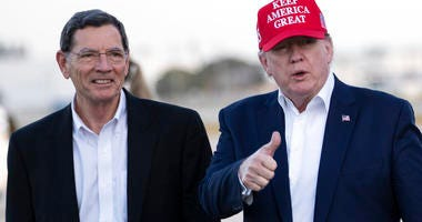 President Donald Trump gives thumbs up as he steps off Air Force One, accompanied by Sen. John Barrasso, R-Wyo., at the Palm Beach International Airport, Friday, Nov. 29, 2019, in West Palm Beach, Fla.