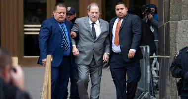Harvey Weinstein, center, leaves court following a bail hearing, Friday, Dec. 6, 2019 in New York.