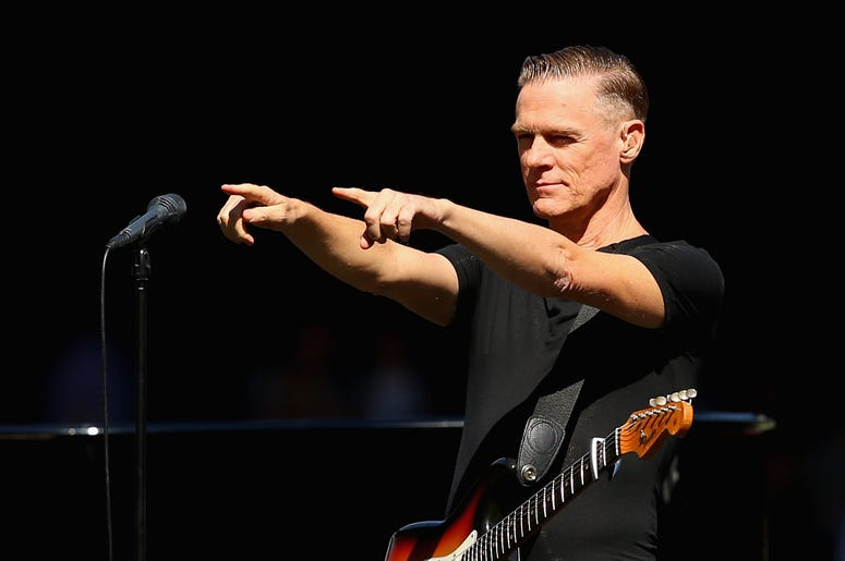 2015 AFL Grand Final - Hawthorn v West Coast  MELBOURNE, AUSTRALIA - OCTOBER 03: Bryan Adams performs during the 2015 AFL Grand Final match between the Hawthorn Hawks and the West Coast Eagles at Melbourne Cricket Ground on October 3, 2015 in Melbourne, A