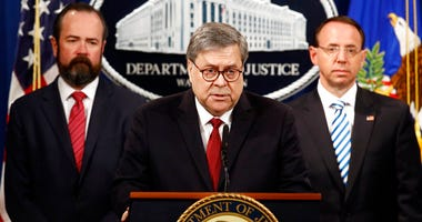 Attorney General William Barr speaks alongside Deputy Attorney General Rod Rosenstein, right, and acting Principal Associate Deputy Attorney General Edward O'Callaghan, left, about the release of a redacted version of special counsel Robert Mueller's repo