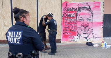 Meaningful Mural Brings Officer and Artist Together