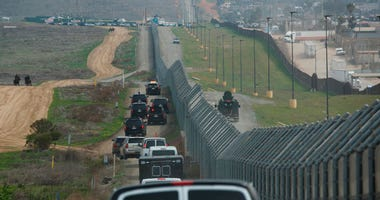 In this March 13, 2018, file photo, a motorcade carrying President Donald Trump drives along the border in San Diego. California has rejected the federal government's initial plans for National Guard troops to the border because the work is considered too