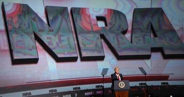 President Donald Trump speaks during the National Rifle Association-ILA Leadership Forum, in Atlanta.