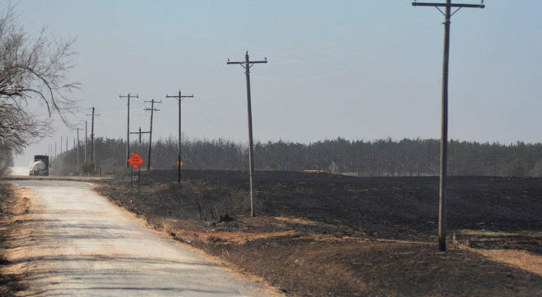 FILE - In this April 17, 2018, file photo, part of the burn area south of Seiling, Okla., are viewed. Recent showers temporarily relieved drought conditions in parts of the southwestern United States, but dry weather will persist through the summer. The d