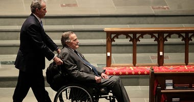 Former Presidents George W. Bush, left, and George H.W. Bush arrive at St. Martin's Episcopal Church for a funeral service for former first lady Barbara Bush, Saturday, April 21, 2018, in Houston