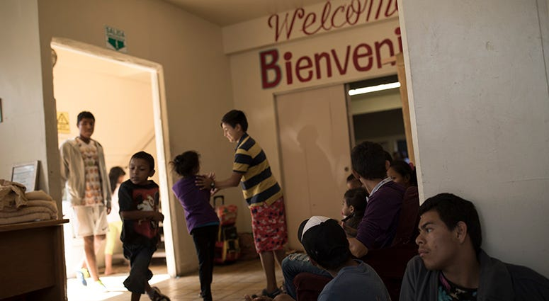 Central American migrants traveling with a caravan wait to be registered at the Viña de Cristo shelter in Tijuana, Mexico, Wednesday, April 25, 2018. The caravan of mainly Central American migrants are planning to request asylum, either in the United Stat