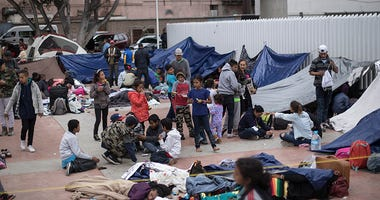 Migrants wait for access to request asylum in the US, at the El Chaparral port of Entry in Tijuana, Mexico, Monday, April 30, 2018. bout 200 people in a caravan of Central American asylum seekers waited on the Mexican border with San Diego for a second st