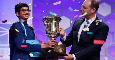 Karthik Nemmani, 14, from McKinney, Texas, holds the Scripps National Spelling Bee Championship Trophy