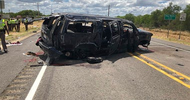 In this image tweeted by David Caltabiano of KABB/WOAI, a heavily damaged SUV is seen on Texas Highway 85 in Big Wells, Texas, after crashing while carrying more than a dozen people fleeing from Border Patrol agents