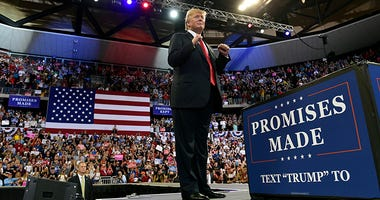 President Donald Trump speaks at a rally at AMSOIL Arena in Duluth, Minn