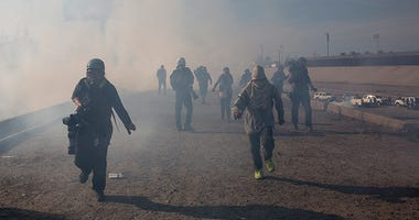 Tear Gas, migrant Caravan