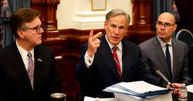 Texas Gov. Greg Abbott, center with Speaker of the House Dennis Bonnen, right, and Lt. Governor Dan Patrick