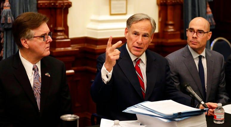 Texas Gov. Greg Abbott, center with Speaker of the House Dennis Bonnen, right, and Lt. Governor Dan Patrick