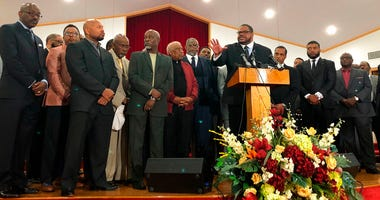 Pastor Kyev Tatum speaks at a news conference at a church to a group of community leaders on Wednesday, Oct. 16, 2019,