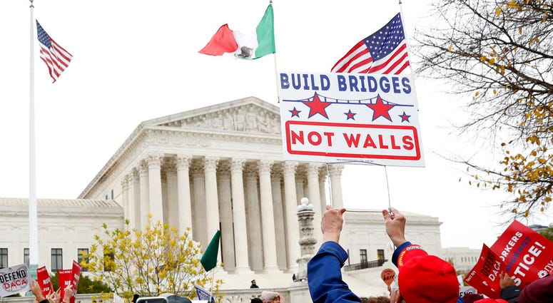 People rally outside the Supreme Court as oral arguments are heard in the case of President Trump's decision to end the Obama-era, Deferred Action for Childhood Arrivals program