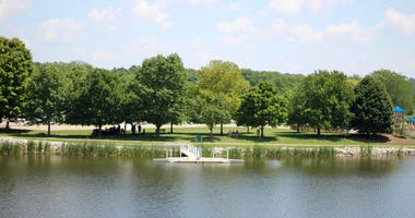 A hot and humid sunny summertime day at the lake in the park.