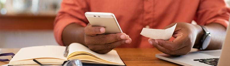 Man Depositing Check With Mobile Phone