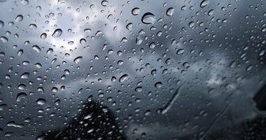 Rain on windshield, dark clouds