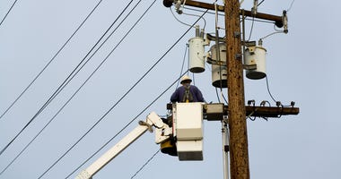 Power company worker, Repairing wires